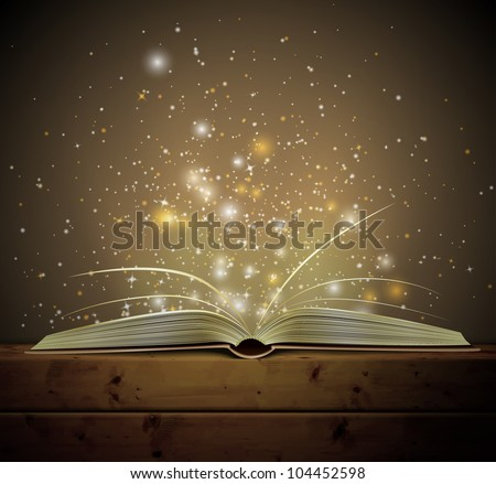 open magic book with the light