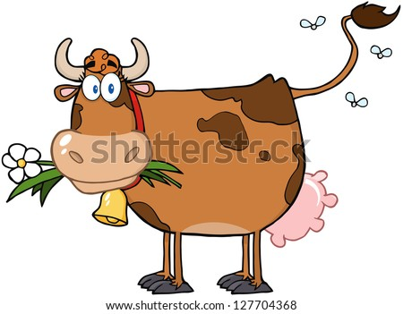 brown dairy cow with flower in