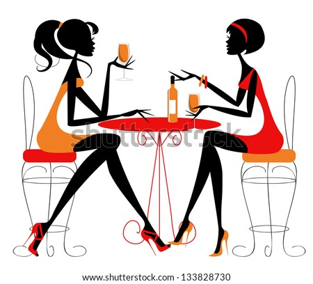 women sharing a bottle of wine