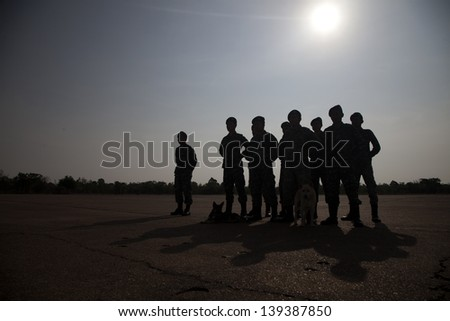 silhouette of soldiers line up
