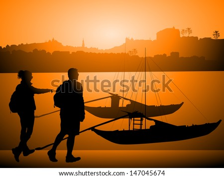 tourists against boats on douro