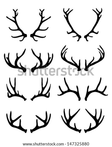 Silhouettes of deer antlers 2-vector stock illustrations