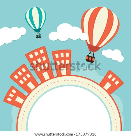 hot air balloons over a town