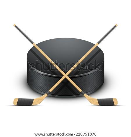 ice hockey puck and sticks