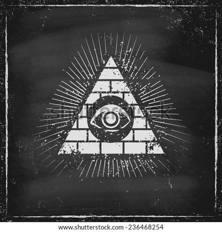 pyramid with eye on chalkboard