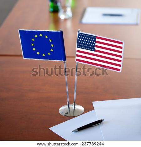 table with two flag usa and eu