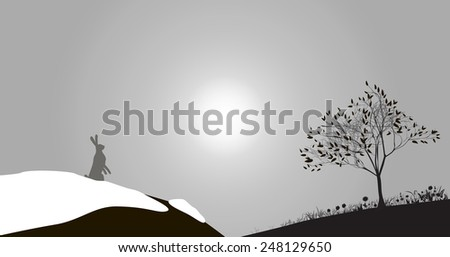 hare on the top of snowy hill
