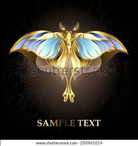moth of gold and bronze with