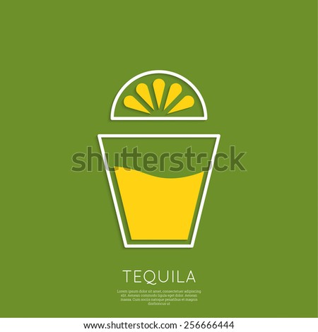 glass of tequila with lemon