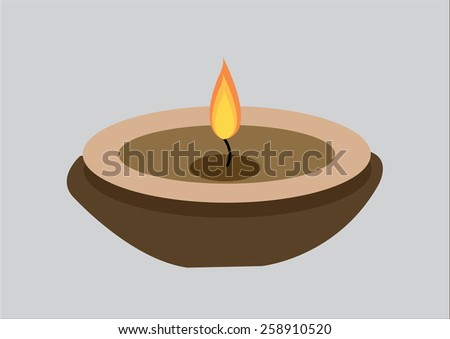candle flame on vintage wooden