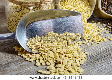 a assortment of dried vegetables on wooden table - stock photo