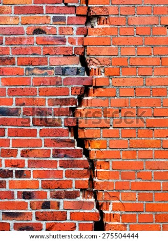 A background brick wall with crack - stock photo
