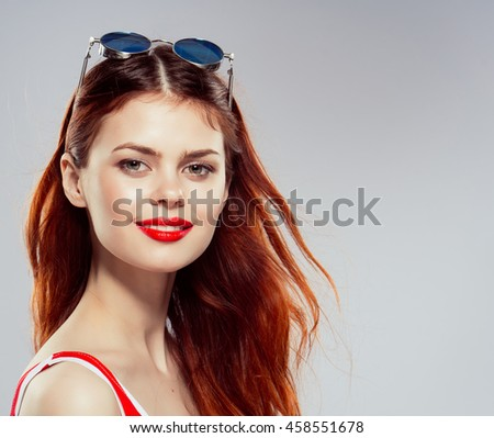a beautiful girl with glasses
