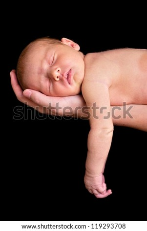 A beautiful newborn baby girl in mother's hands - stock photo