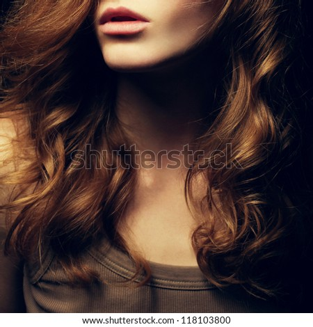 A Beautiful red-haired girl's portrait. Natural hairstyle. Healthy Hair. Close up. Studio shot - stock photo