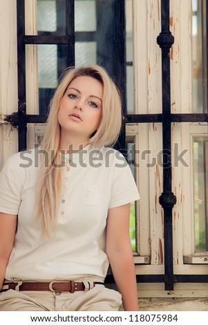A beautiful young woman sitting - stock photo