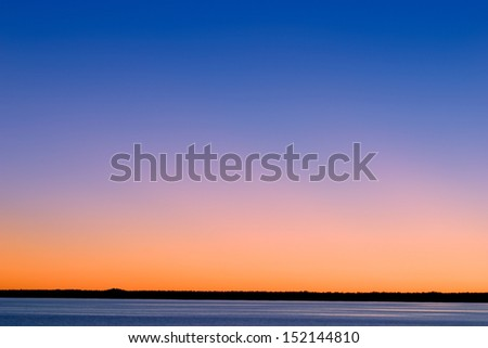 A Blazing And Colorful Sunset Sky Background Towering Over Lake Michigan In The Upper Peninsula Of Michigan, USA - stock photo