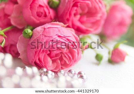 A bouquet of beautiful, delicate pink roses with pink beads. Background of roses - stock photo