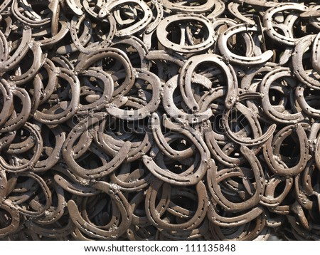 a bunch of welded horseshoes for luck - stock photo