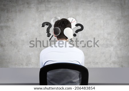 A businessman thinking about his work and tasks and plans. Icons of different actions are flying around his head. - stock photo