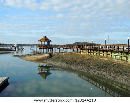 A charming gazebo glows in the late afternoon sunshine of a tranquil day, on the scenic inter-coastal waterway of South Carolina. - stock photo