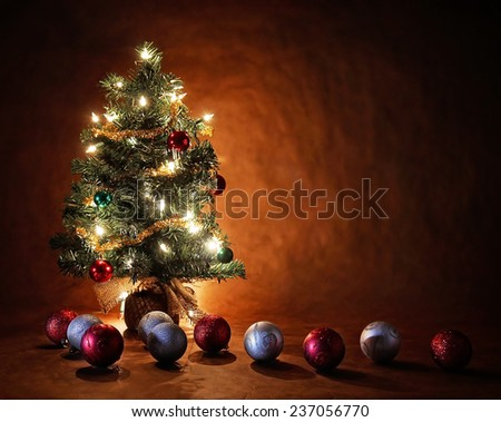 a christmas tree with lights and ornaments long exposure  - stock photo