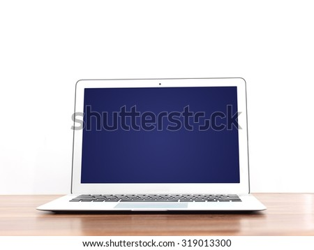 A close up shot of a open laptop - stock photo