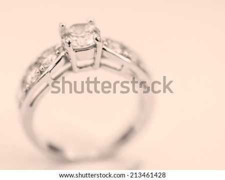 A contemporary diamond ring isolated on vintage background.  - stock photo