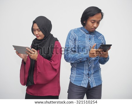 A couple engrossed with mobile devices. - stock photo