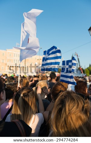 a crowd holding Greek waving flags Protesting for NO in Athens demonstration demonstration against austerity measures, - stock photo