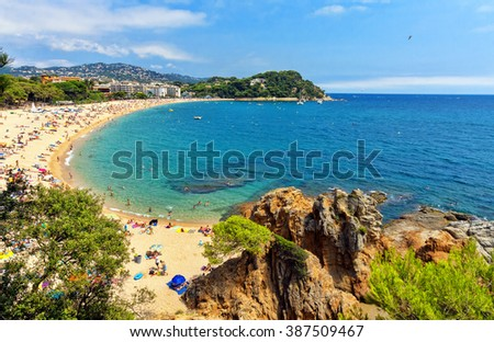 A crowd of vacationers enjoy the warm beaches of Costa Brava in Lloret de Mar.