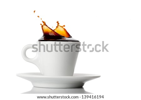 a cup of coffee with splash