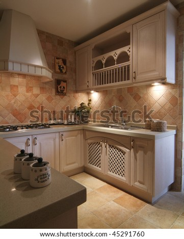 A finished kitchen with classic decoration.