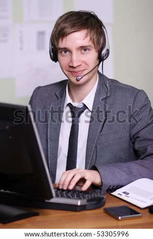 A friendly telephone operator in an office environment.