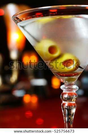 A gin martini is seen in a bar.