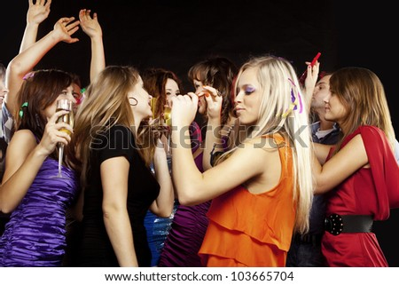 A group of young beautiful people dancing at a disco.