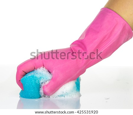 A hand wearing pink glove washing by blue sponge with foam