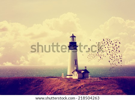 a lighthouse with a flock of birds toned with a retro vintage instagram filter effect