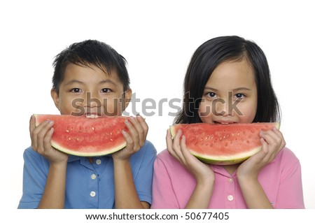 A little couple eating watermelon - stock photo