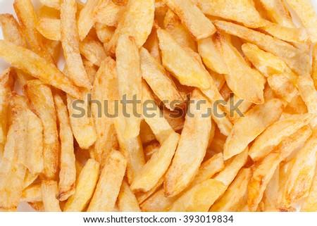 a lot of delicious french fries cooked at home on a white background. - stock photo