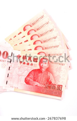 A lot of 100 New Taiwan Dollar bill on white background