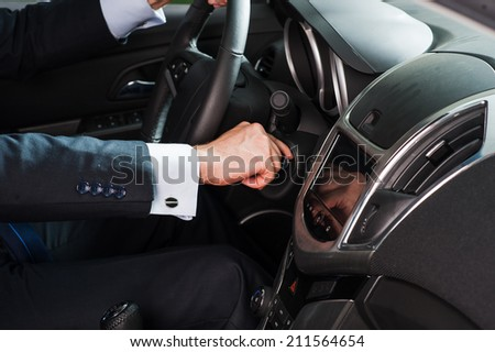 a man starts a car - stock photo