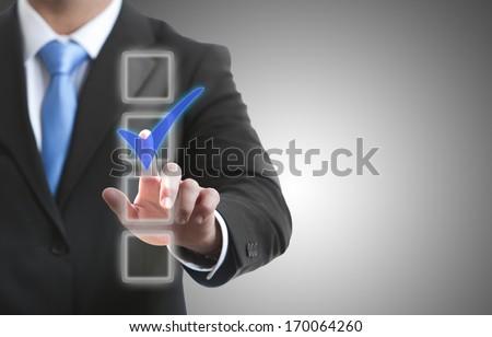 A man touching a button on a futuristic touchscreen interface  - stock photo