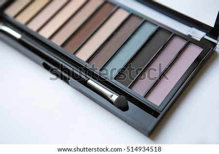 A neutral toned palette of eye shadow colors  on light background