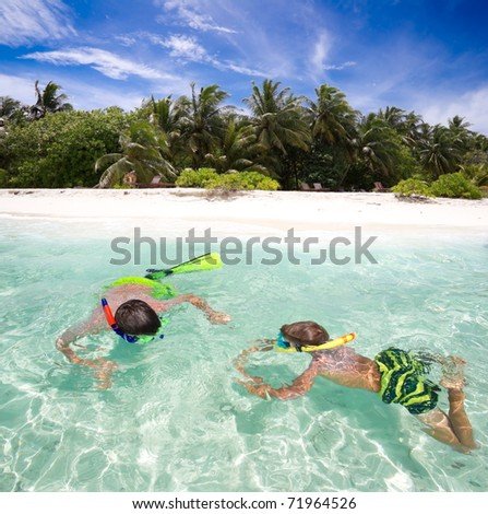 A pair of kids snorkeling.