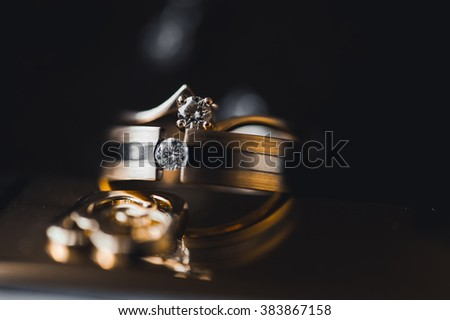 a pair of wedding wedding rings of gold for the bride and groom kurpnym up with diamonds and precious stones