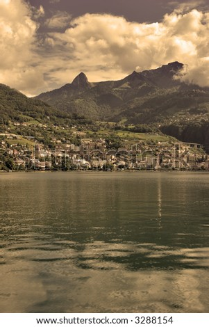 A panorama of coast of lake Leman in Switzerland in Sepia. - stock photo