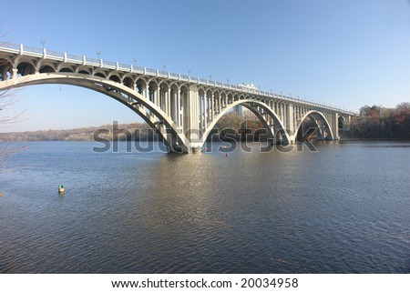 A picture of a long bridge reaching across Mississippi river - stock photo
