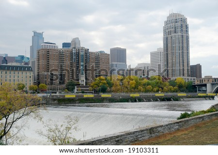 A picture of Minneapolis skyline from St. Anthony's fall - stock photo