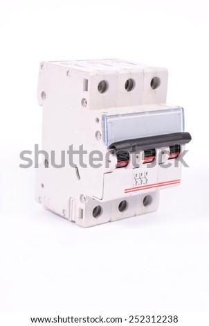 A 3 pole miniature circuit breaker - stock photo
